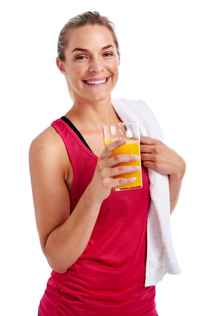 woman with camera: Woman getting ready for gym workout with towel and orange juice in studio Stock Photo