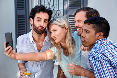 photo pictures: friends taking photo pictures selflie with mobile cellphone camera outdoors at garden party