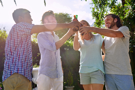 beer drinking: group of friends having outdoor garden party with alcoholic beer drinks Stock Photo