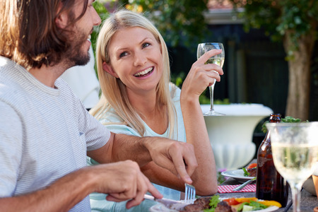 other keywords: group of friends enjoying their outdoor dinner party