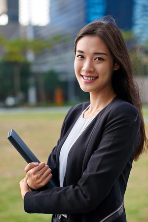 modern businesswoman: professional asian chinese business woman portrait outdoors
