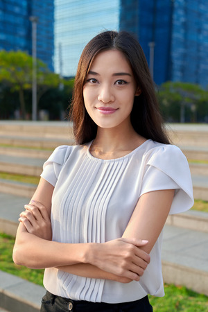 portrait of asian chinese businesswoman office worker in downtown business district on sidewalk 스톡 콘텐츠