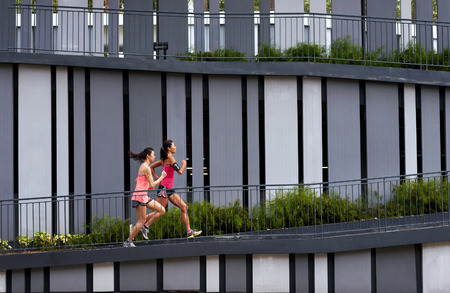 uphill: sporty woman running uphill outdoors for morning workout