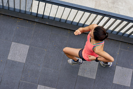 personas trotando: overhead view of active sporty woman training outdoors for marathon run in morning Foto de archivo