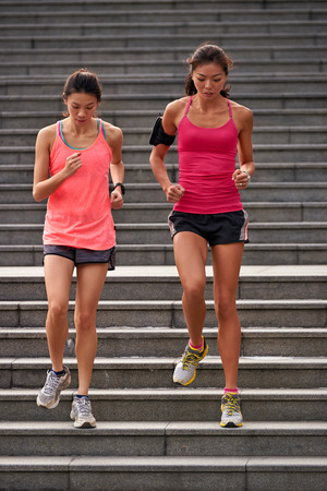 run down: active sporty asian chinese women working out running down stairs outdoors for morning workout