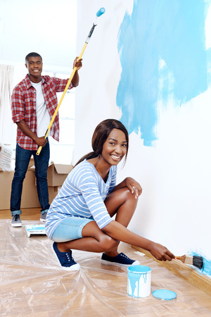 new home: Fresh coat of paint on new apartment for young black african couple who have success and a home
