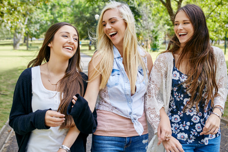 teens: happy fun teen girl friends walking in park laughing on weekend
