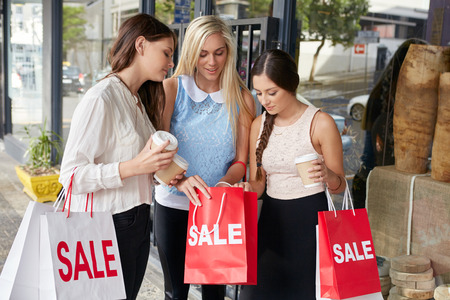 spree: Teenager girls on shopping spree holding sale bags in city Stock Photo