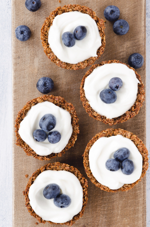 party pastries: Overhead of fresh blueberry tarts with healthy yoghurt filling