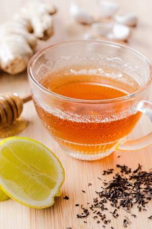 soothing: Ginger tea with lemon, honey, garlic for a healthy soothing detox drink Stock Photo