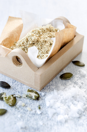 grinded: Salt grinded with nuts and pumpkin seeds as a salad topping, food sprinkle or garnish