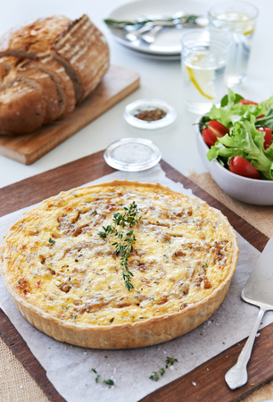 lunch meal: Quiche lorraine tart frittata pie light meal for lunch served with green salad and loaf of bread Stock Photo