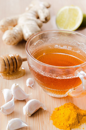 Cup of tea with ginger, lemon, honey, garlic, tumeric for spicy detox drink