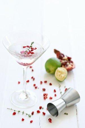 pips: Martini cocktail mocktail with lime and  pomegranate pips