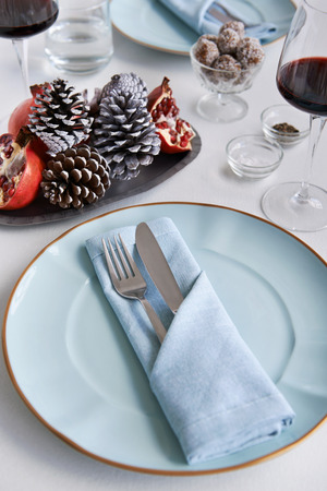 domestic life: Party place table setting for christmas holidays, folded napkin with silverware