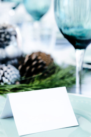 place card: Christmas table setting in blue white and green theme with empty place card