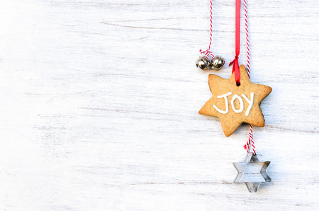 silver bells: Christmas background with gingerbread decorations, silver bells and star cookie cutters, plenty of copy space Stock Photo