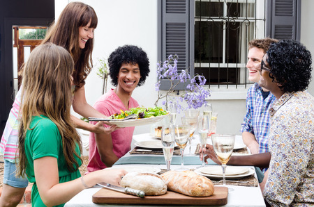 racial: Serving appetisers to multi racial friends at a casual lunch gathering