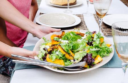 ensalada de verduras: Healthy green vegetable salad served on a table set for a party outdoors in the garden Foto de archivo