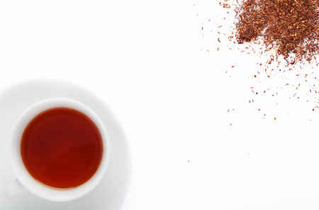 detoxing: Cup of south african rooibos tea, healthy non caffeine detoxing drink with loose scattered leaves