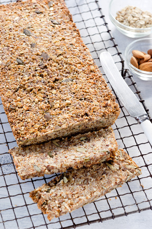 multi grain: Loaf of healthy seeded multi grain whole wheat wholemeal bread with nuts, pumpkin, sunflower, sesame, flax seeds and almonds Stock Photo