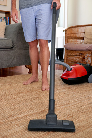 doing chores: Caucasian male doing domestic chores at home