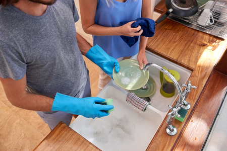 Over view of couple doing household chores in the kitchen Reklamní fotografie - 45973994
