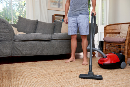domestic chores: Caucasian male doing domestic chores at home