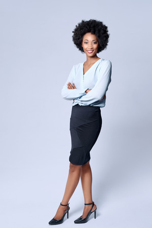 attractive people: Full length portrait of attractive young black african model wears smart business attire in studio and smiling Stock Photo