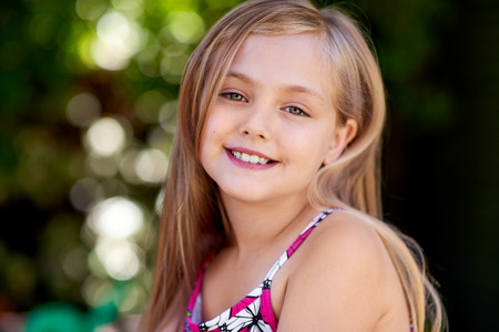 blond girl: Portrait of little blond girl with a charming smile.