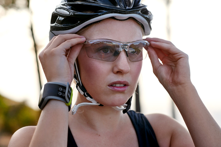 young female wearing protective cycling glasses 版權商用圖片 - 45973840