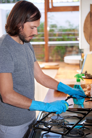 chores: male doing household chores in the kitchen Stock Photo