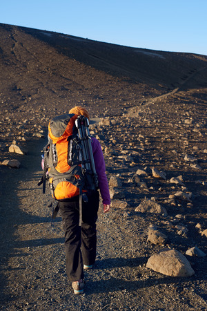 adventure holiday: Young asian woman hiking in Iceland with backpack and outdoor gear on vacation holiday travel adventure