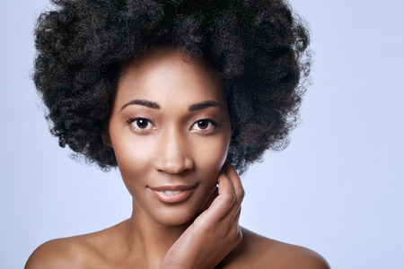 Portrait of beautiful young black african model in studio with smooth complexion flawless skin Stock Photo