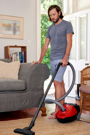 chores: Caucasian male doing domestic chores at home