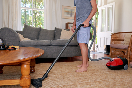 domestic chore: Caucasian male doing domestic chores at home