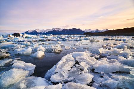 scenary: Broken melting pieces of ice at Jokulsarlon glacier Lagoon, stunning icy  scenary landscape in iceland