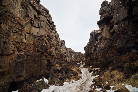 crevice: hiking trail along Crevice in geological significant thingvellir national park, site of tectonic plate movement, iceland