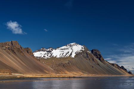 scenary: Remote dramatic iceland cliff landscape with clear blue skies, picturesque scenary travel tourism
