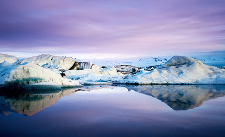 beautiful sunset: Jokulsarlon glacier Lagoon with floating icebergs and reflection in southeast iceland, a famous natural tourist attraction