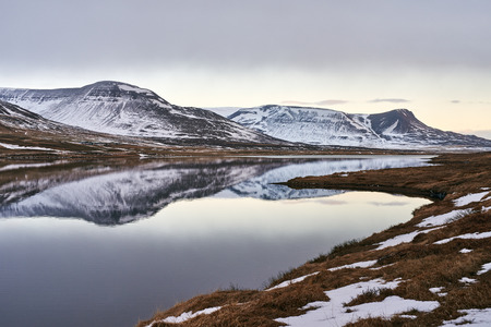 serene landscape: Landscape of snowy mountains reflecting in the still lake water, serene idyllic vista