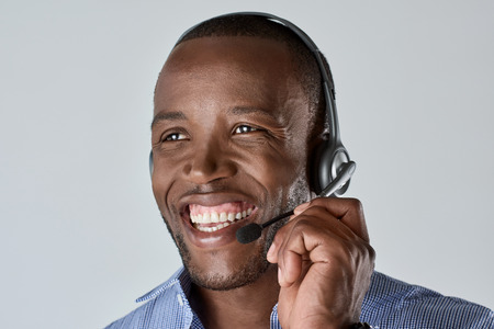 microphone headset: African male customer service personnel operator smiling with microphone headset Stock Photo