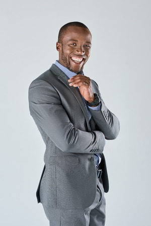 african business man: Confident african business man in suit smiling in studio