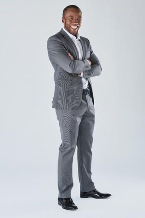black professional: Full length portrait of positive friendly black  professional businessman in business suit isolated in studio