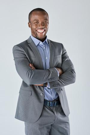 black businessman: Confident black businessman in suit smiling in studio