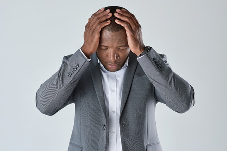 african business man: Black african business man feeling stress, having a headache migraine, facing deadline in studio