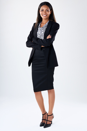 woman business suit: Full length business woman portrait wearing a black suit, smiling with arms crossed Stock Photo