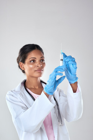 medical cure: Female medical professional scientist researcher holding a syringe injection jab  vaccination cure discovery