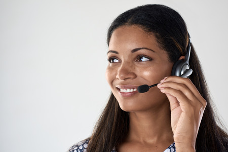 Beautiful hispanic latino indian woman with headset, support call centre staff for assistance