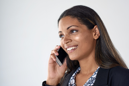 beautiful indian woman talking smiling on her mobile cell phone smartphone